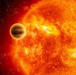 Ein Exoplaneten um seinen Heimatstern - künstlerische Darstellung © ESA, C. Carreau